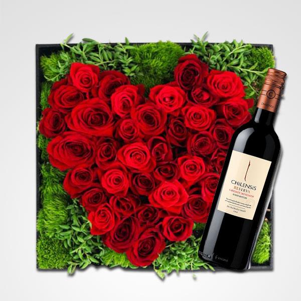 pave floral rosas rojas y botella reserva floreria bogota