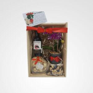 ancheta caja dotacion selecta botella de vino gato negro chocolates orquidea