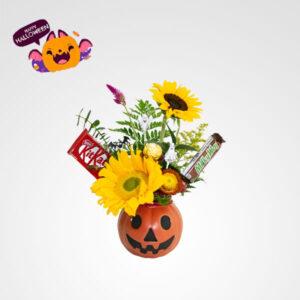 arreglo de flores girasoles con dulces chocolates calabaza halloween